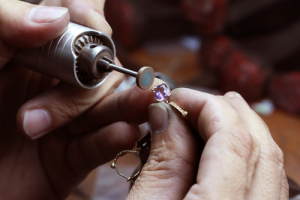 Artisan creating jewelry.