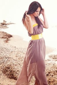 Woman in maxi dress with belt.