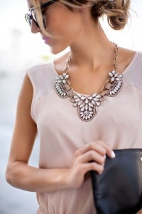 Statement Necklaces worn with sleeveless top.