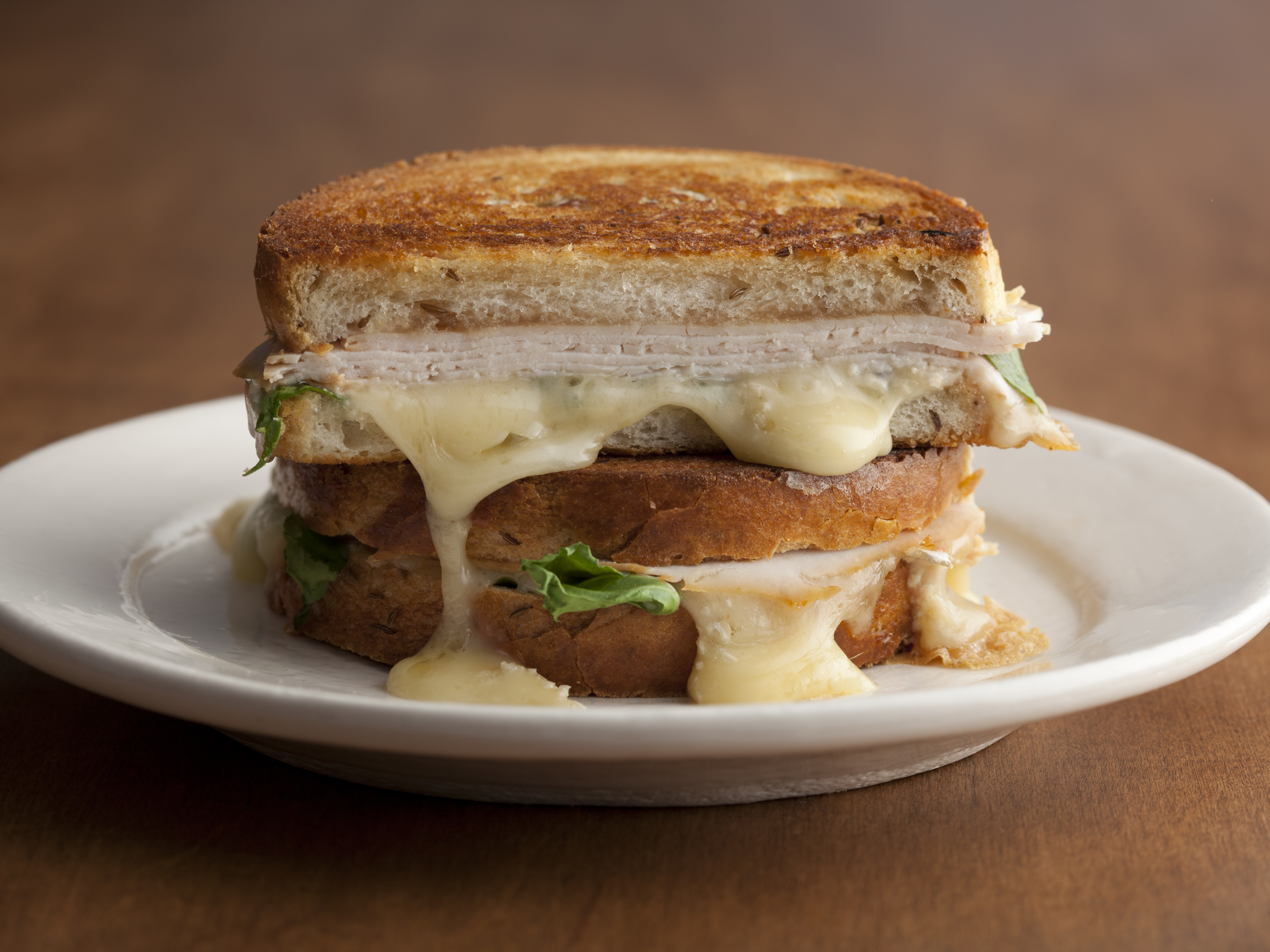 Grilled Turkey, Brie, and Apple Butter Sandwich with Arugula; Tyler Florence