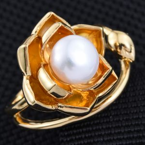 White freshwater pearl ring in floral setting, finished with 14K yellow gold.