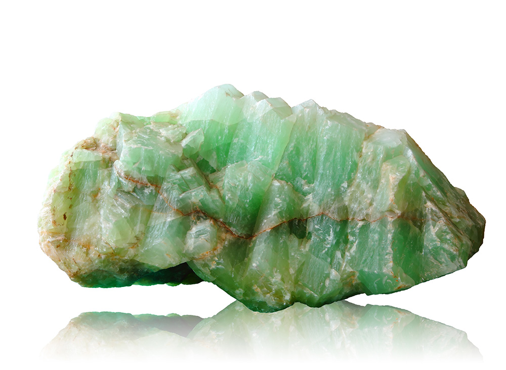 Raw jade against white background.