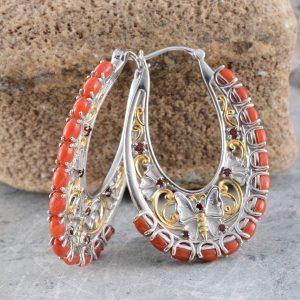 Coral hoop earrings style.