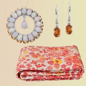 Opal hoop earrings, citrine dangle earrings, and a floral blanket.