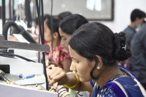 Woman manufacturing jewelry.