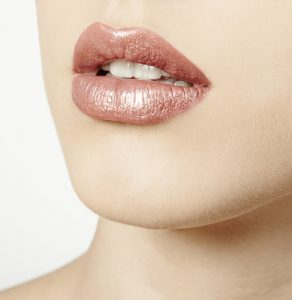 Closeup of woman with metallic lipstick.