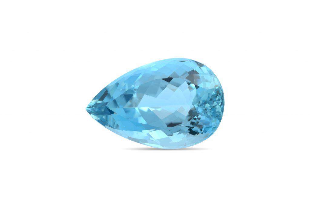 Pear-shaped aquamarine gemstone against white background.