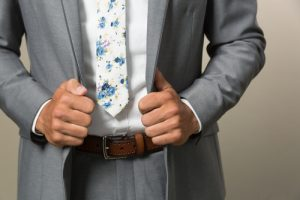 Floral tie with a suit jacket.
