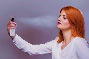 Woman using setting spray.