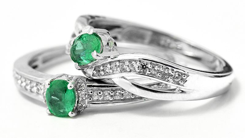 Stacked Brazilian emerald rings.