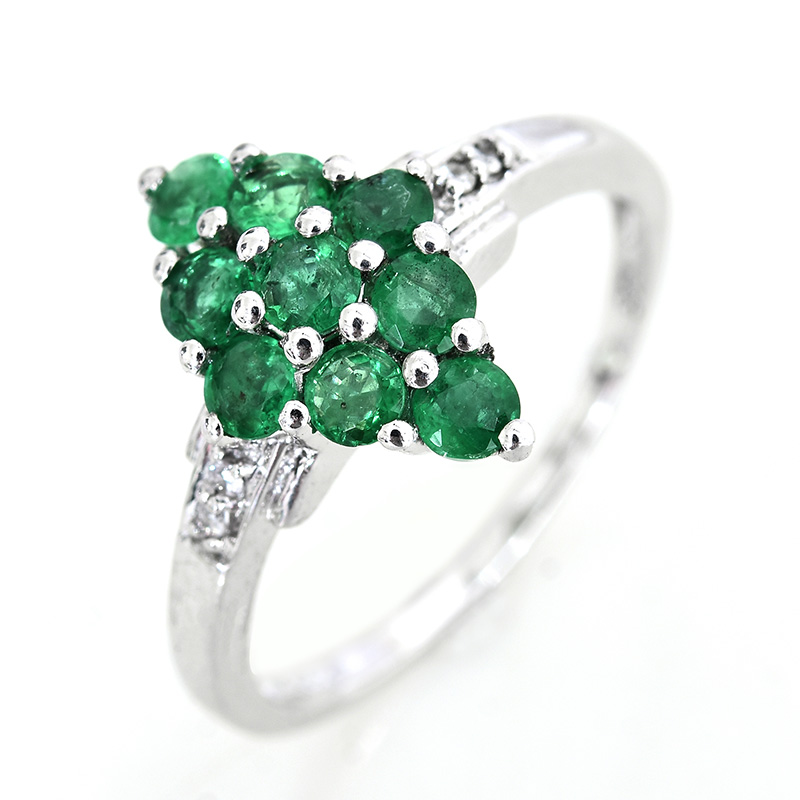 Brazilian emerald ring against white background.