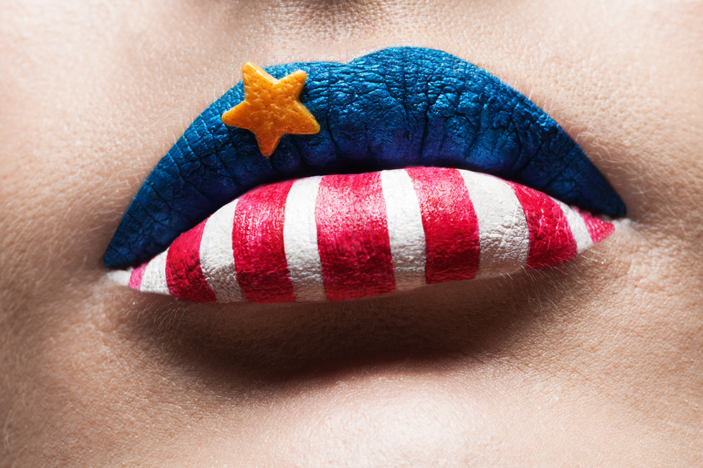 Closeup of American flag painted lips.