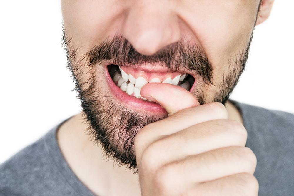 Man biting his nails.