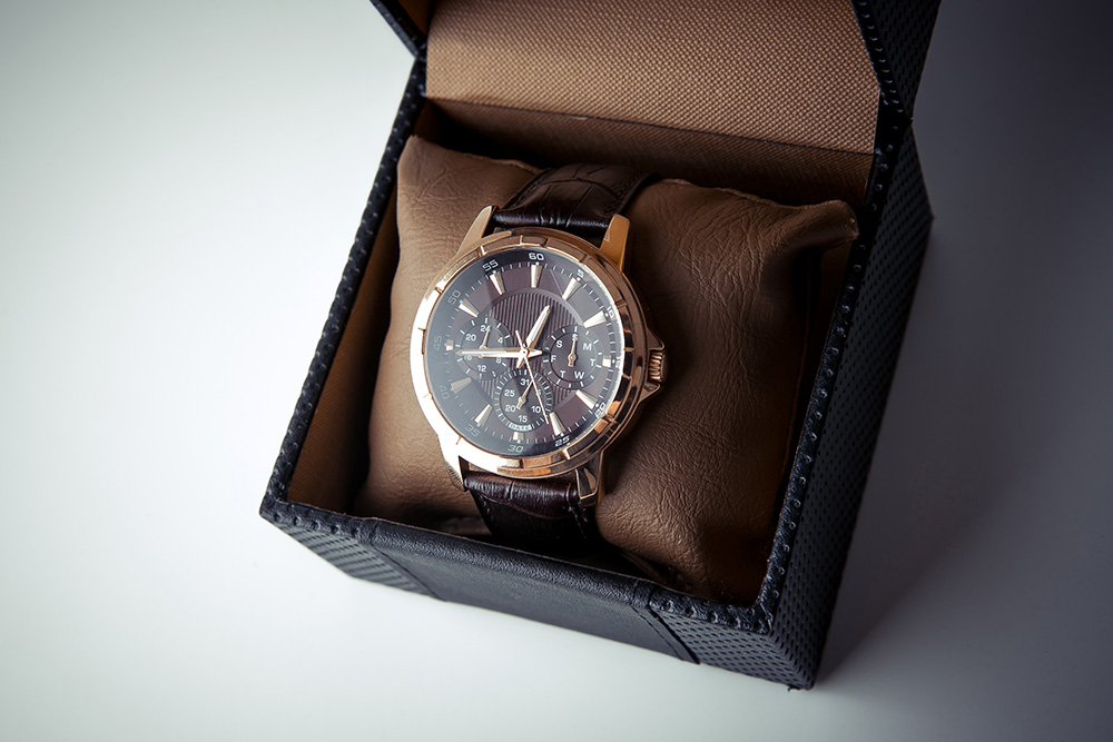 Closeup of men's watch in the box.