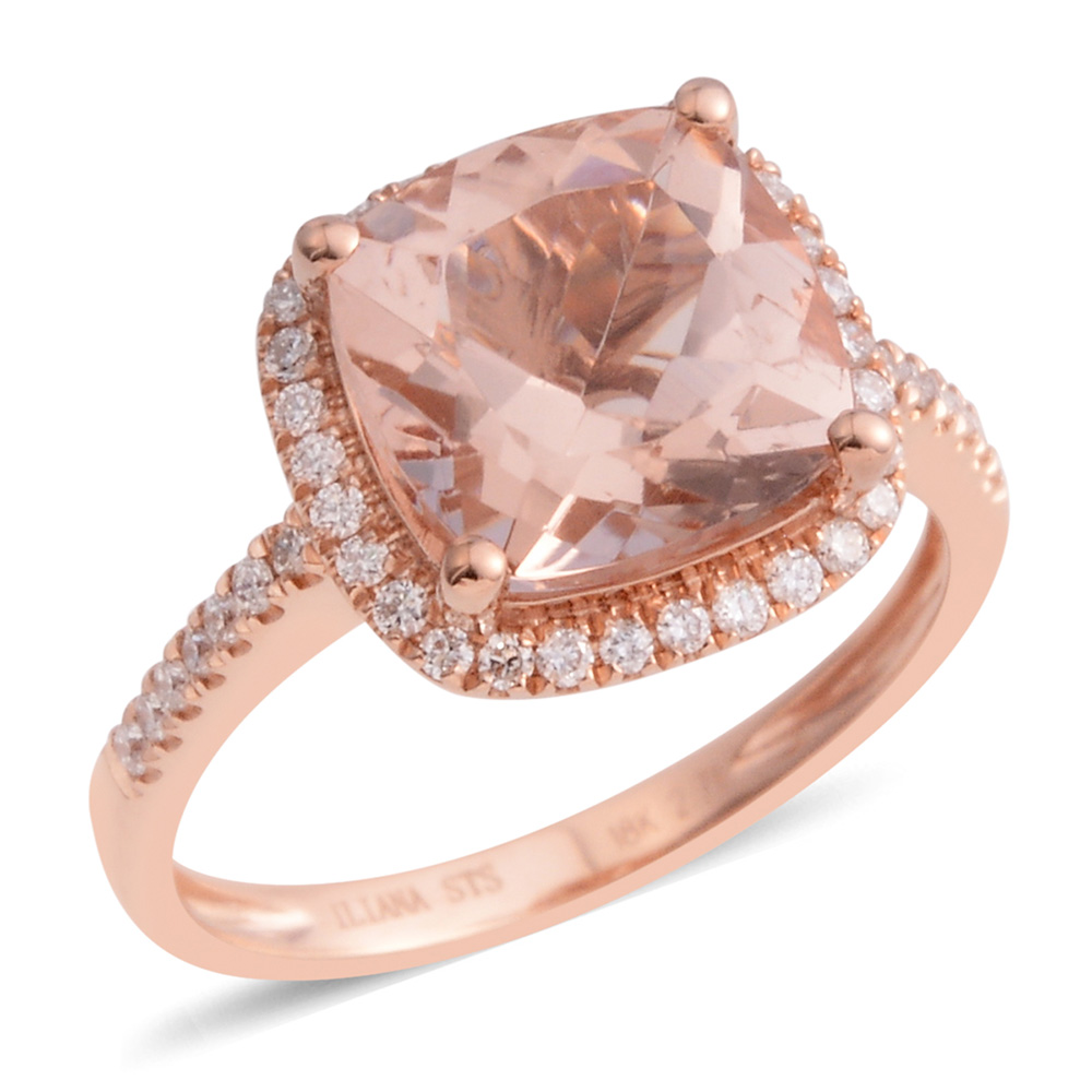 Closeup of rose gold ring with pink morganite gemstone against white background.