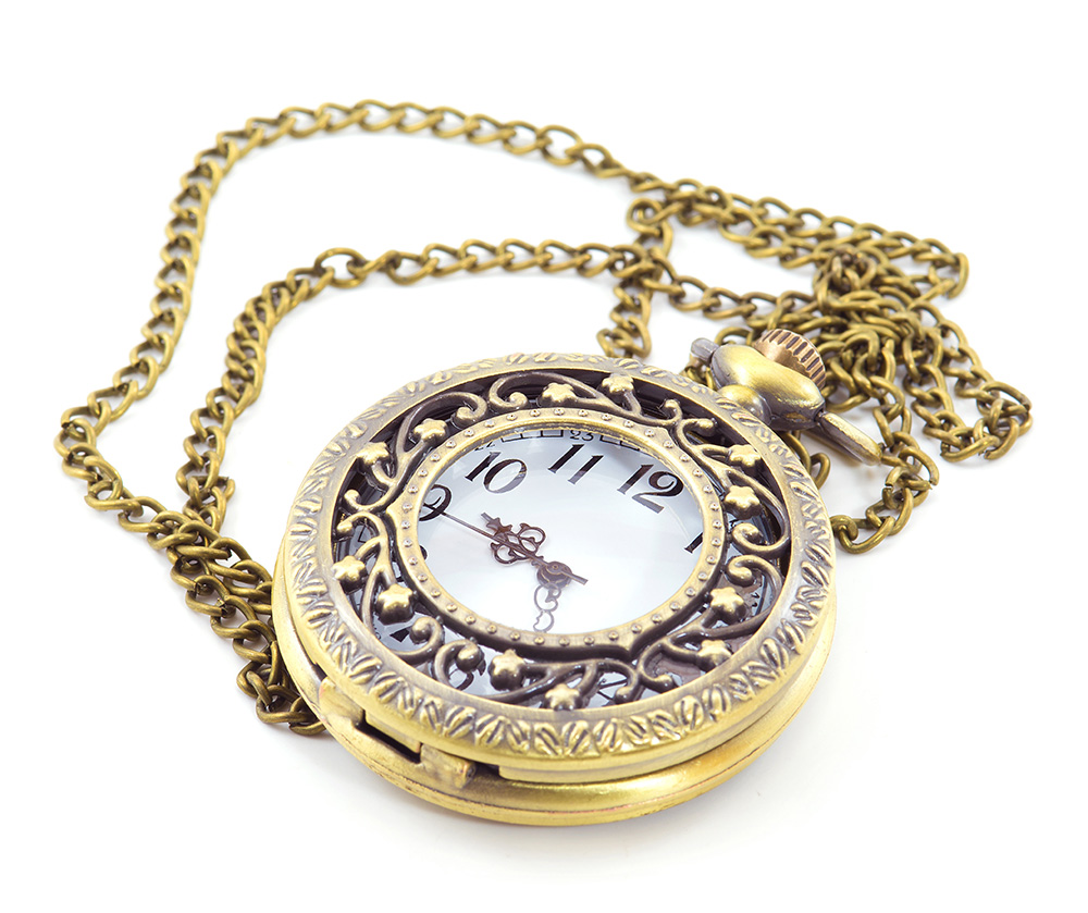 Golden pocket watch against white background.
