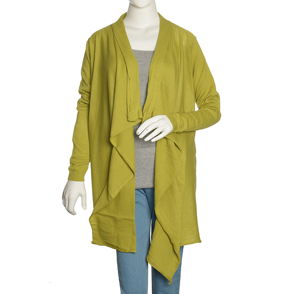 Mannequin with mustard green coverup, gray shirt and blue denim.