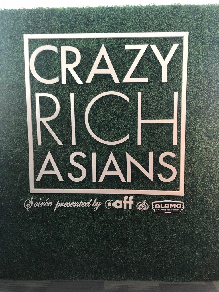 Crazy Rich Asians backdrop featuring sponsors
