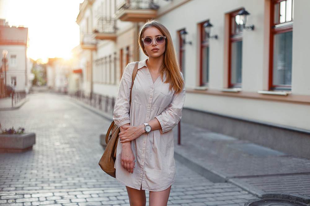 Woman standing in the street with shift dress.
