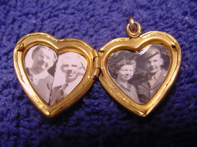 Small heart locket with picture of a young and old couple.