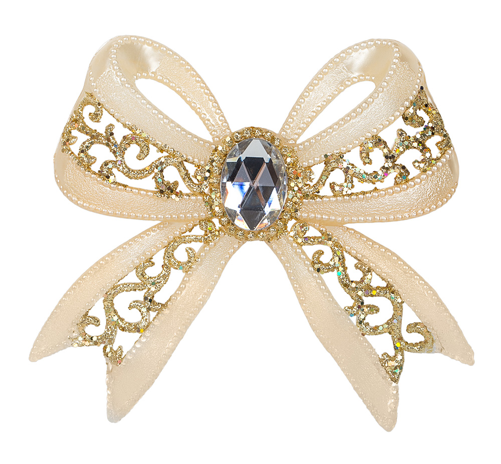Closeup of champagne colored bow brooch against white background
