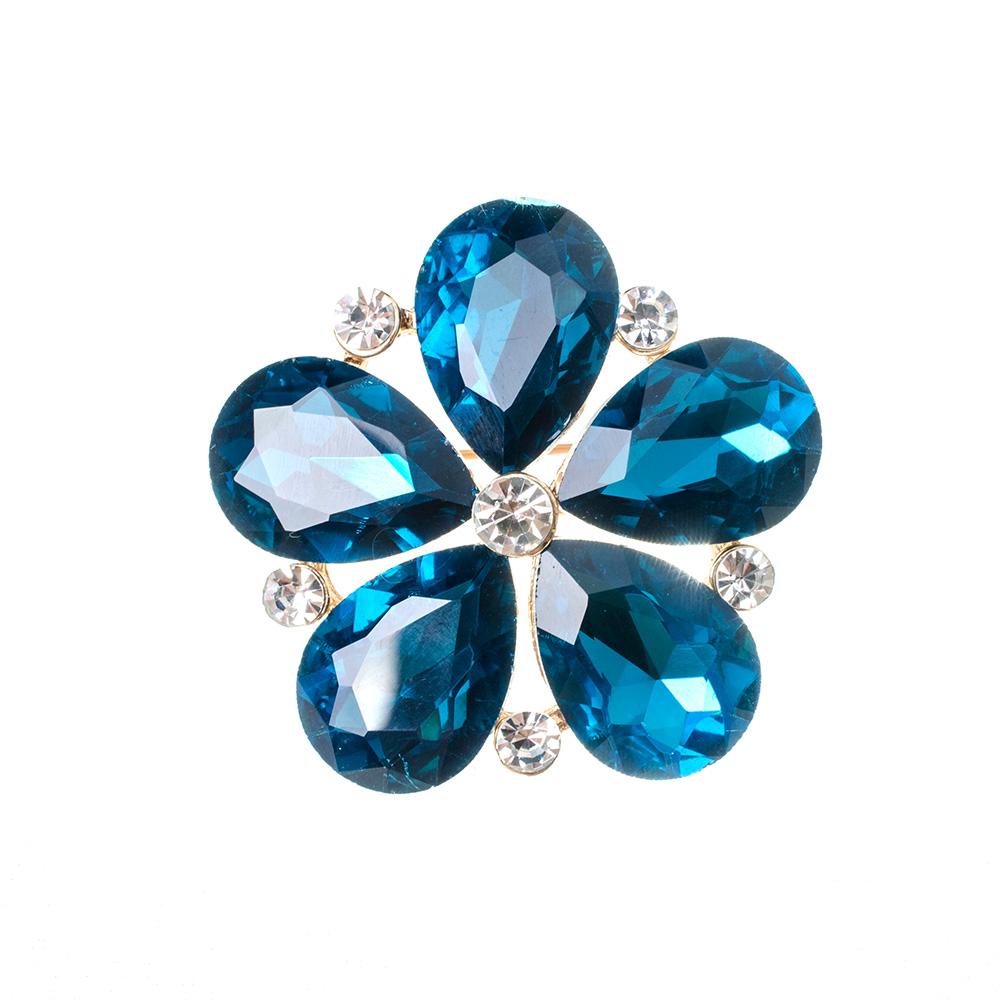 Closeup of blue flower gemstone brooch