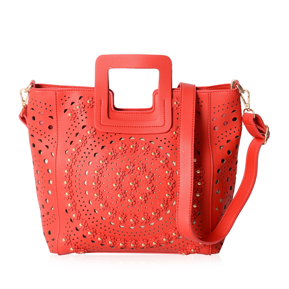 Closeup of red handbag against white background