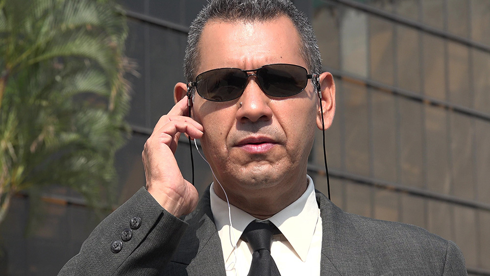 Man dressing up as Agents from Men in Black outside