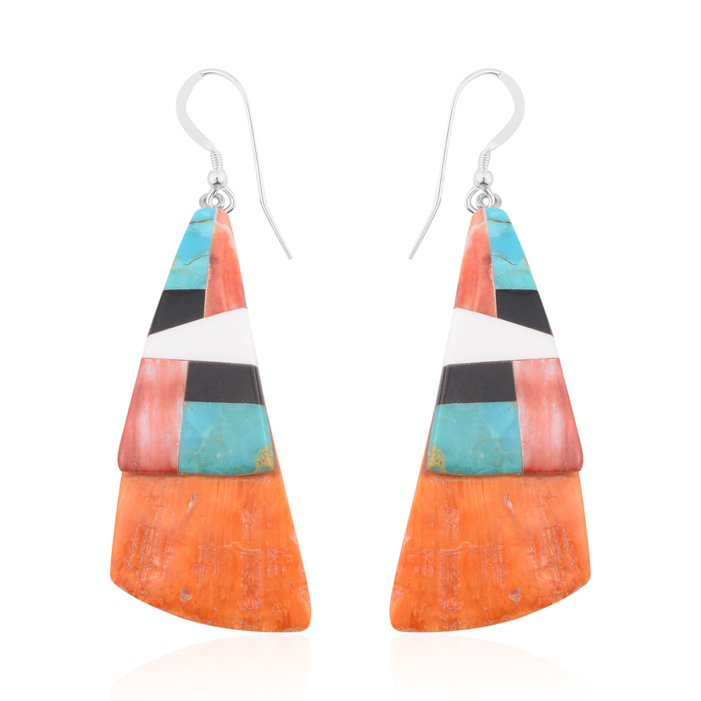 Closeup of orange, blue, and blush Sante Fe style drop earrings