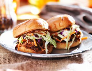 Shredded pork sliders topped with fresh coleslaw.