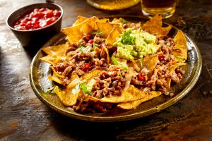 Delicious beef nachos and guacamole.