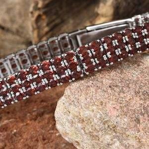 Mozambique garnet bracelet resting on rock.