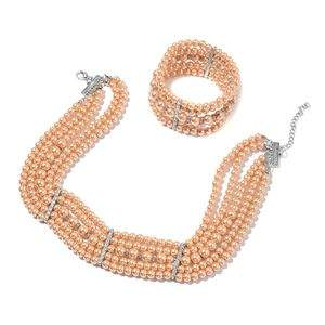 Champagne simulated pearl necklace and bracelet.