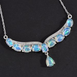 Welo opal Y-necklace against black backdrop.