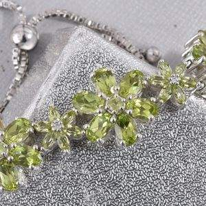 Close-up on peridot bracelet crafted in floral design.