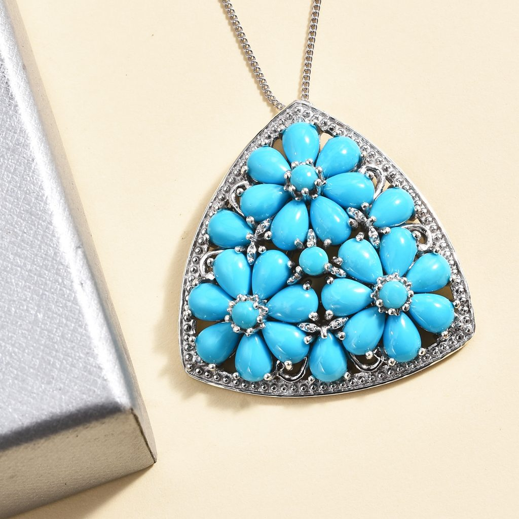 Sleeping Beauty Turquoise floral pendant necklace in sterling silver.