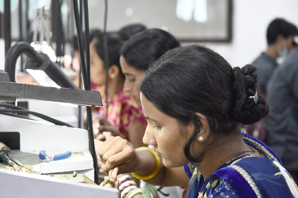 Woman manufacturing jewelry.