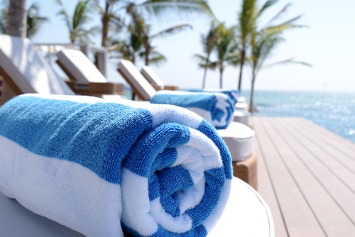 A rolled up blue and white pool towel.