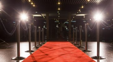 red carpet rolled out with lights surrounding it