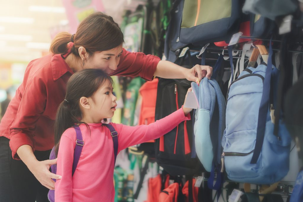 Mother and daughter shopping for a backpack.
