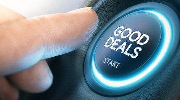 "Finger pushing ""Good Deals"" button"
