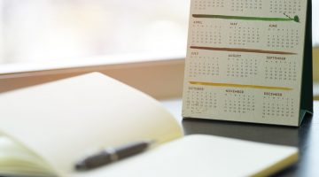 Calendar with a notebook and a pen