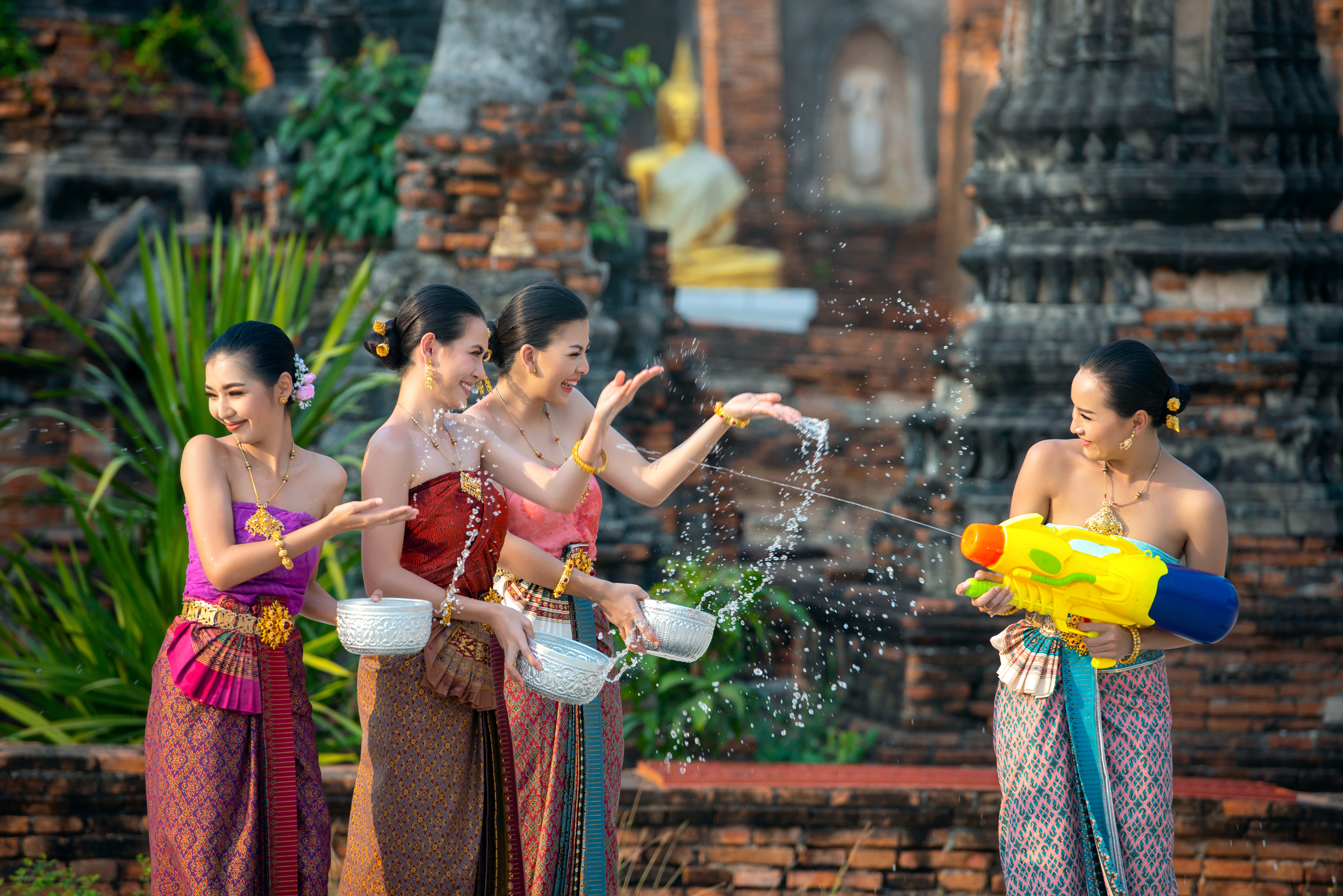 Cambodian women celebrating New Year with traditional water play.