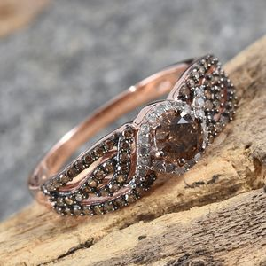 Champagne diamond open shank ring on wood pedestal.