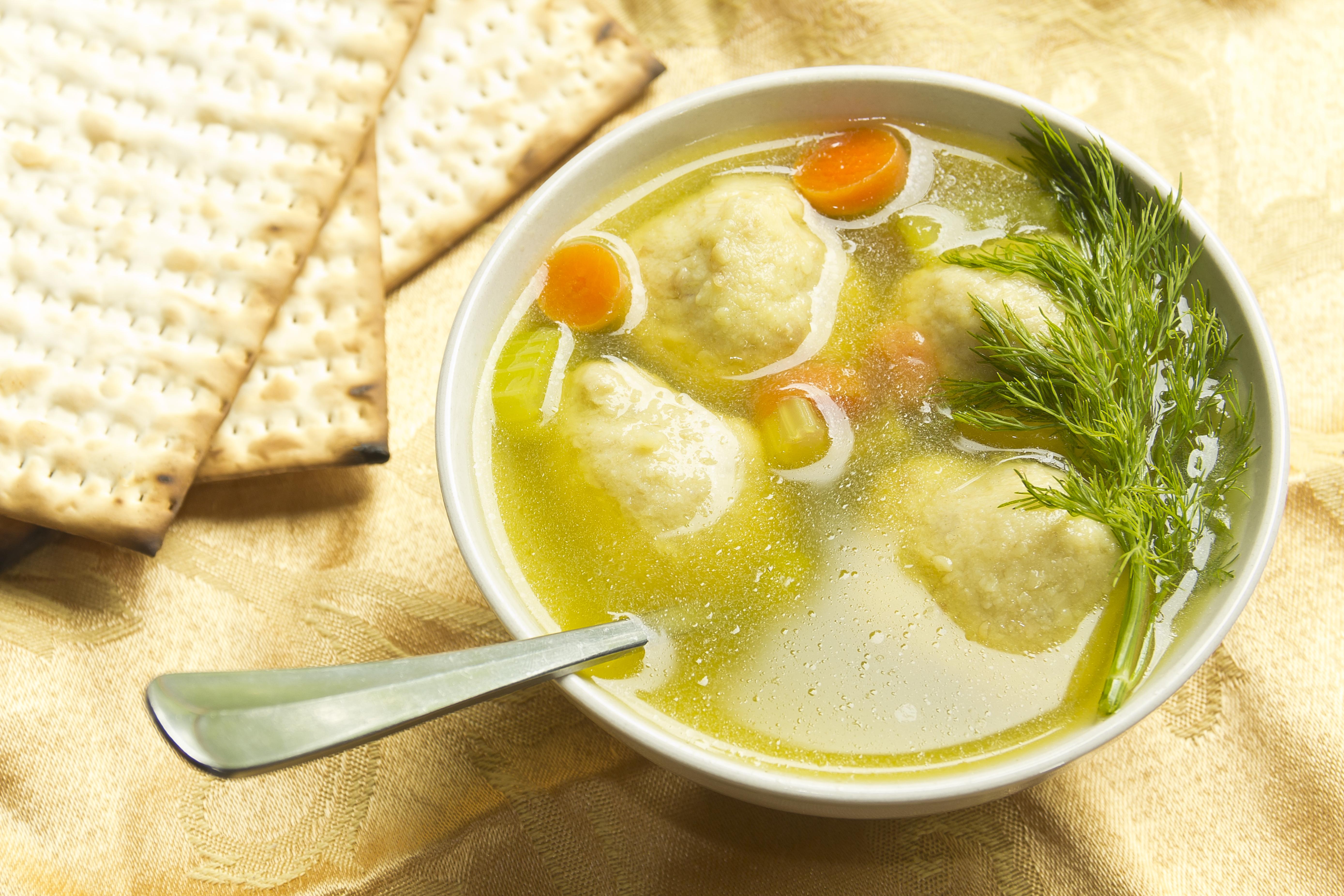 Freshly served bowl of Matzo ball soup.