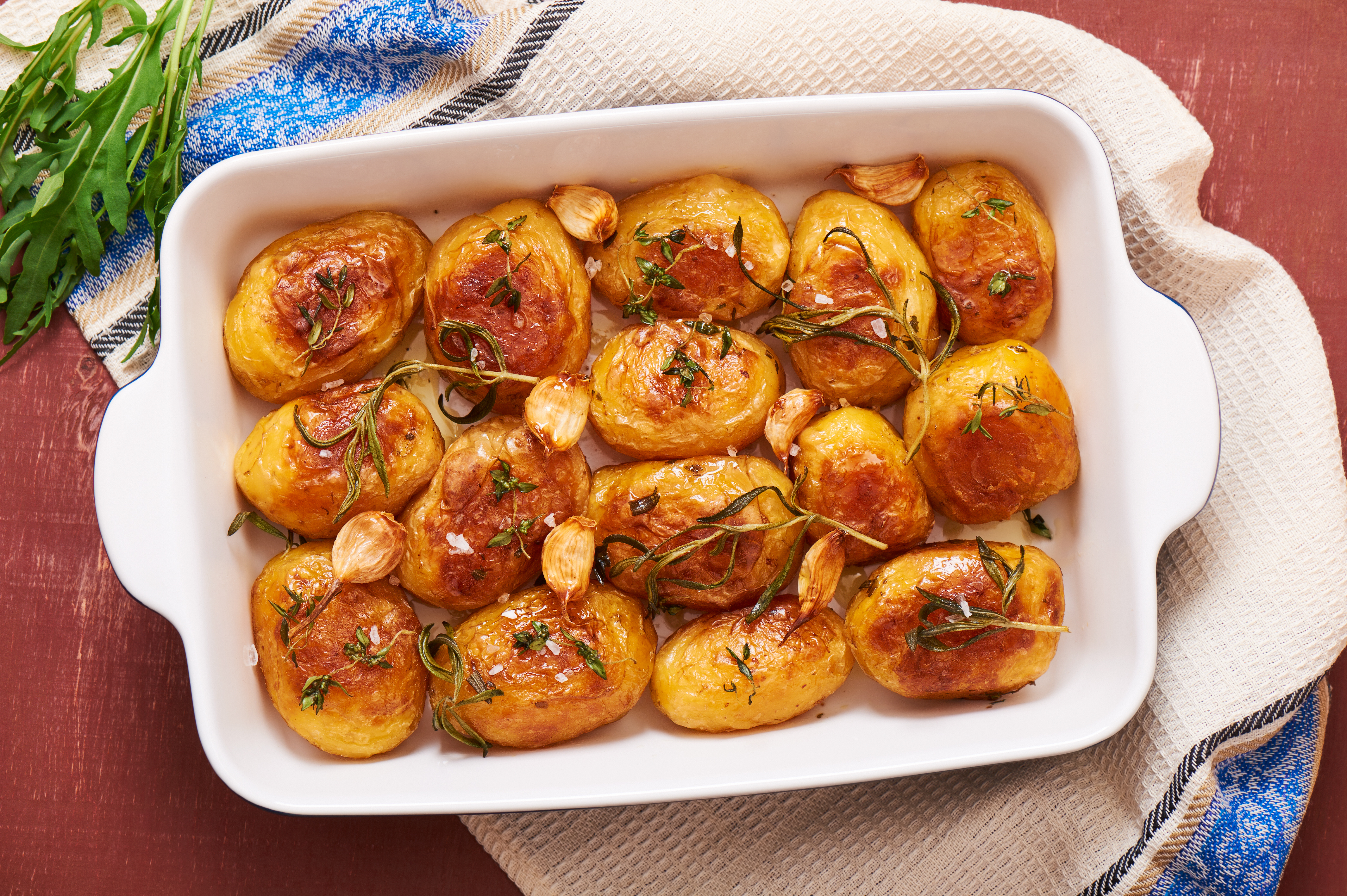 Piping hot tray of delicious roasted potatoes.