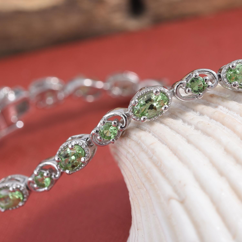 Mint garnet line bracelet displayed artfully.