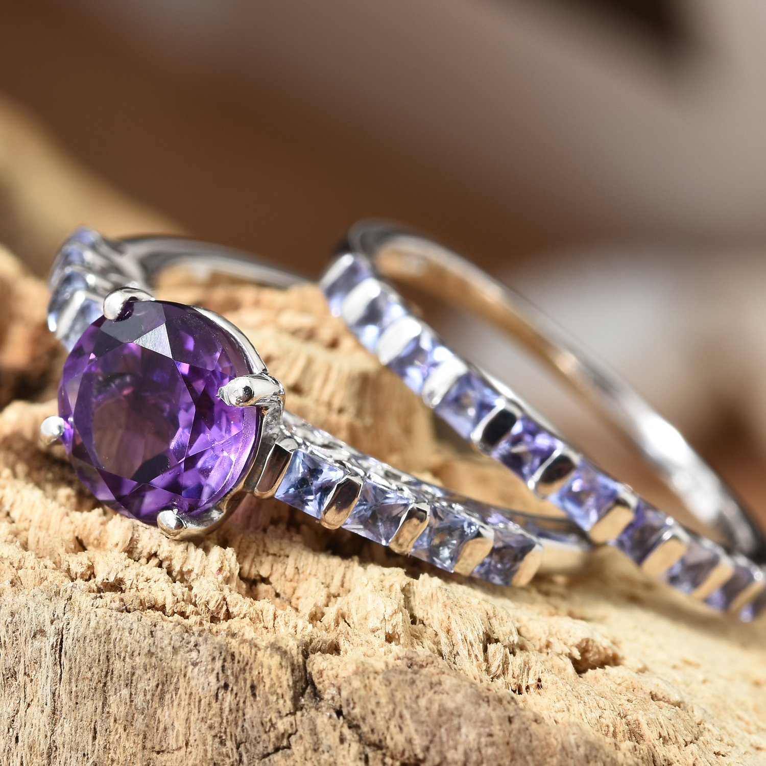 Moroccan amethyst ring set displayed on wooden stand.