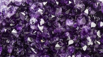 Closeup of deep purple amethyst crystals.