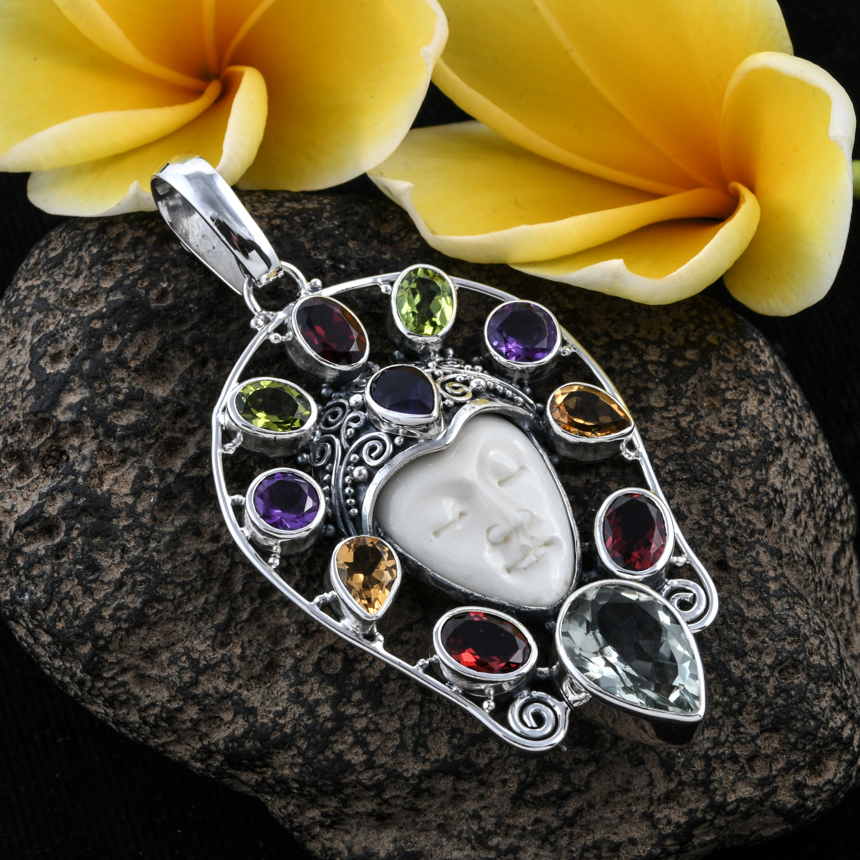 Jeweled Bali jewelry pendant with resting goddess face.